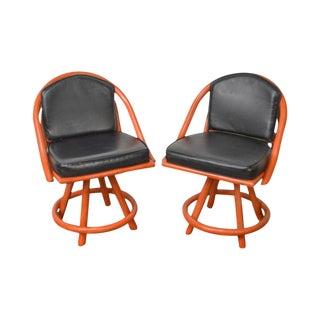 Mid Century Pair of Red Bamboo Swivel Arm Chairs W/ Black Vinyl Seats