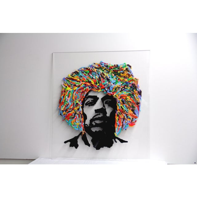 Jimmy Hendrix portrait on acrylic paints poured in a three dimensional manner on a clear acrylic panel for the hair & bits...