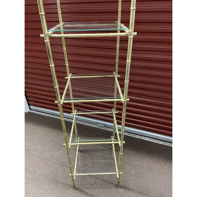 This Etagere was bought a Pairs flea market and shipped back to the states. It is metal with a gold finish in faux bamboo...