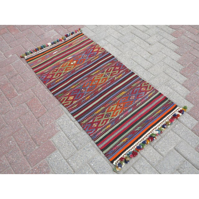This handmade door mat from westhern of turkey . Oushak nomads embroidered wool kilim rug. Small striped rug carpet....