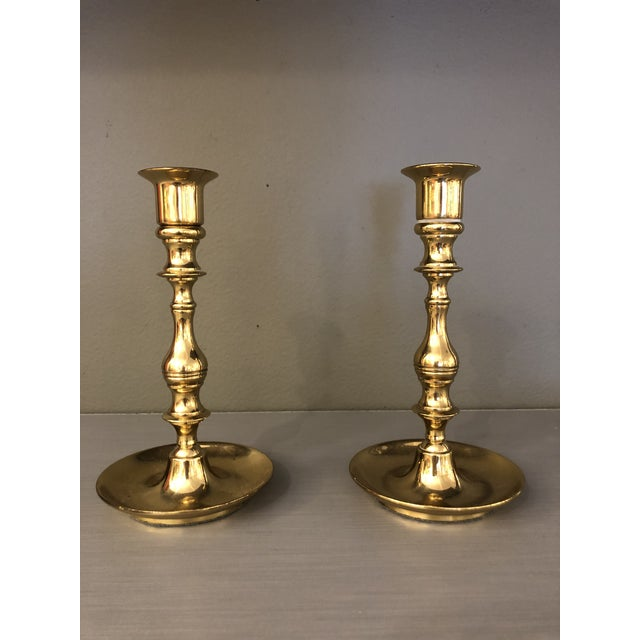 Mid century pair of brass candleholders would occur face the top holes can fit a regular candle very good condition with...