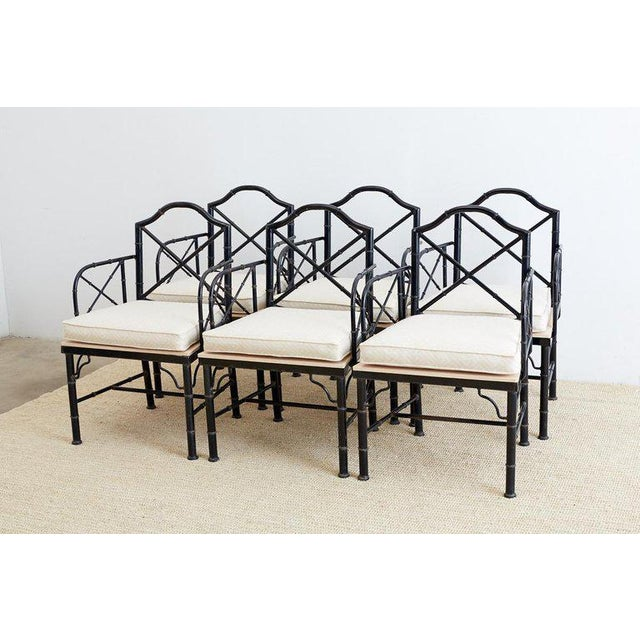 Rare set of six faux bamboo garden patio dining chairs made of wrought iron in the Chinese Chippendale taste. From the...