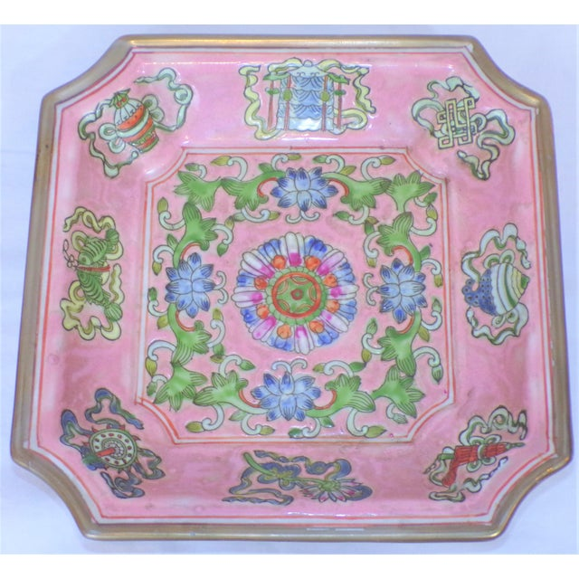 This is a 1970's Chinese Export ceramic square catchall dish. The colors are beautiful in a blush pink ground with...