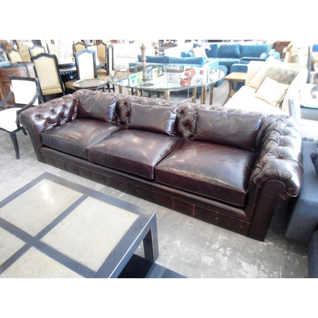 This is a practically brand new Kravet sofa. It's very deep and luxurious. There is a shiny finish to the leather that you...