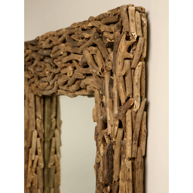 Reproduction driftwood mirror imported from England.