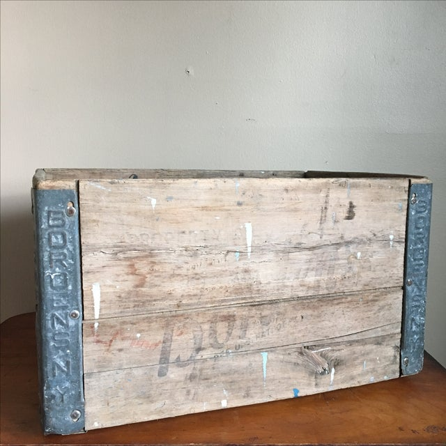 Incredible antique crate from Borden's in New York. Wooden crate with metal reinforcements along the sides that have the...