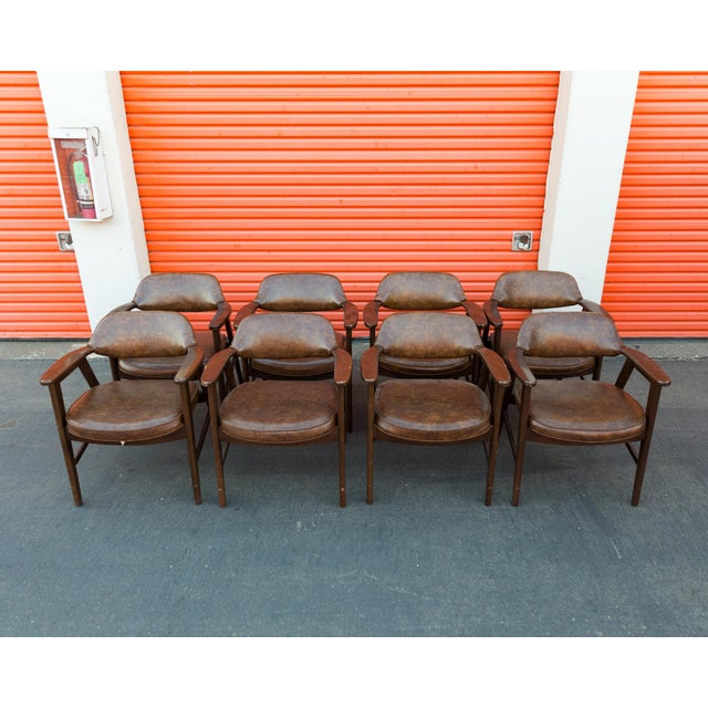 A set of eight Mid Century Modern Paoli Chair Co. chairs. This set includes eight chairs, constructed circa 1980. Each...