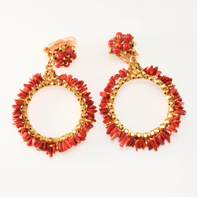 Clip earrings in a top and drop hoop dangle design. These are made up of natural coral rocks and arum colored rhinestones...