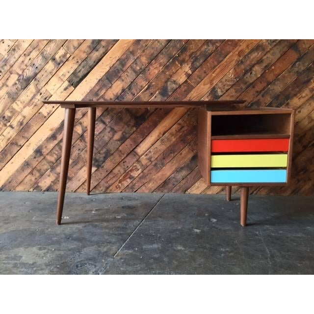Newly built, Mid-Century-style, custom walnut desk, featuring a floating top, and three color blocked drawers with storage...