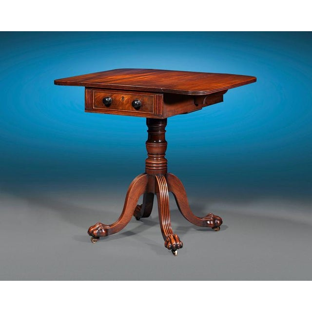 Boasting wonderfully grained and patinated mahogany of the highest caliber, this early Regency-period Pembroke table is...