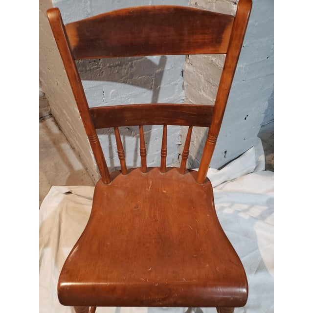 Small spindle back Windsor chair from the early 19th century, no makers mark. Nicely grained, looks to be beech wood and...