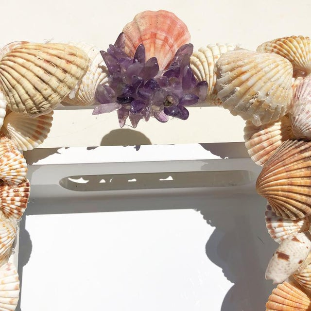 Beautiful found Shell photo Frame. The frame features several different types of shells and purple gem stones. The frame...