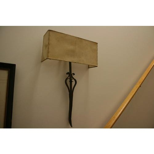 Unique 18th Century wrought iron fragment sconce with beautiful parchment shade. *Please remember: The majority of our...
