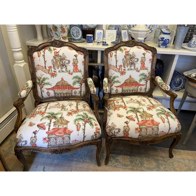 This is a pair of Antique chairs that are carved in fruitwood. They have been recently reupholstered with designer fabric....