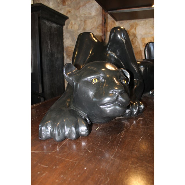Black panther coffee table base. As is, can provide a glass quote if needed.