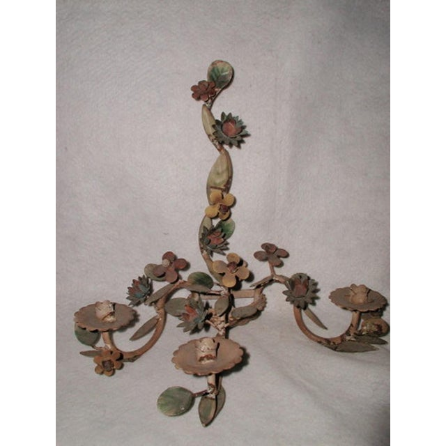 Italian early 1900s metal floral three-candle sconce with original paint. Could be wired easily if desired. The three...