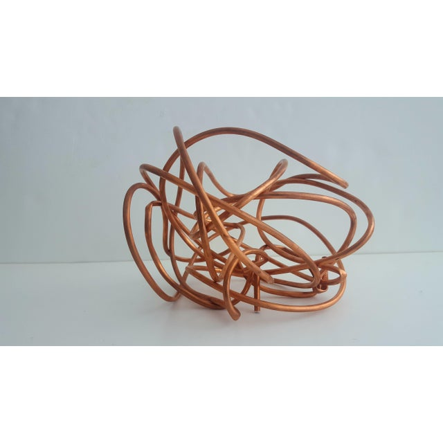 Inspired by Kelly Wearstler's Brass Knot Sculpture, this piece is constructed of Copper This abstract table top sculpture...