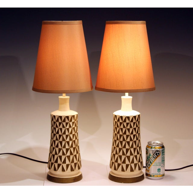 "Vintage pair of FAIP chalkware lamps with white and gold geometric decor in relief, circa 1960's. 22"" high overall, 12"" to..."