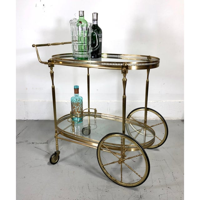 French vintage brass wheeled bar cart with glass interior shelves and beautifully detailed elements with pierced gallery...