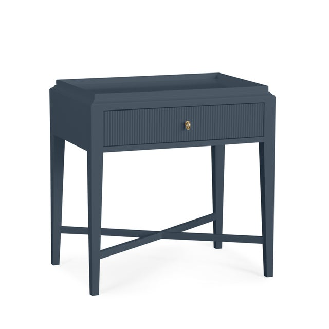Please note this is a made to order product and with a lead time to make. This bedside table has one reeded drawer with a...