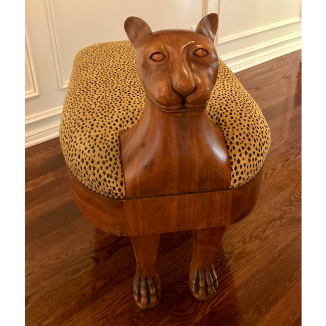 Custom upholstered cat Ottoman with nailhead trim. Pristine condition. Unique and sturdy piece of furniture that adds...