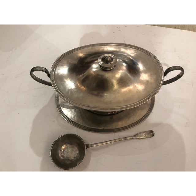 A great looking soup tureen and matching ladle, both functional and a beautiful decorative accessory, having an aged...