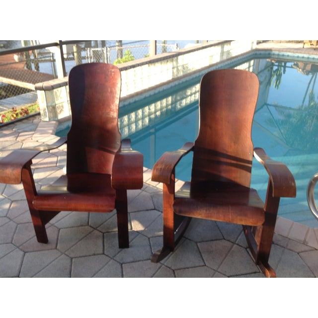 Stunning wooden paddle arm chairs! Very comfortable.