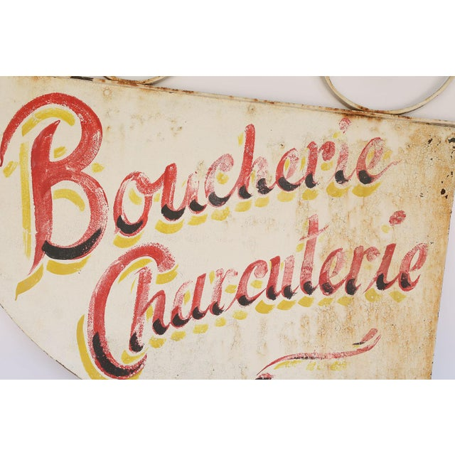 This is a hand painted Boucherie Charcuterie French sign. It once hung in a French butcher shop. French to English...