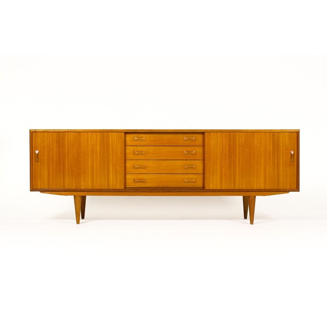 Fantastic vintage specimen credenza. Manufactured by Clausen + Søn in Silkeborg, Denmark. Teak construction with the high...