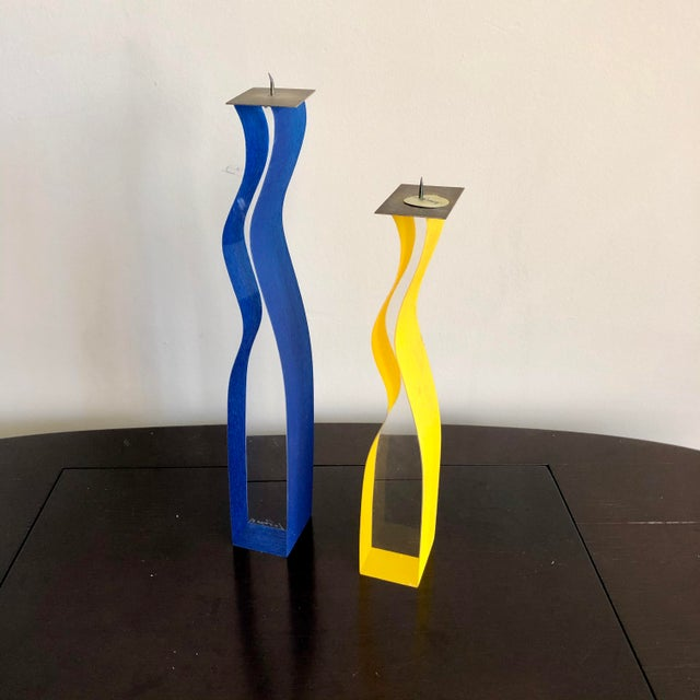 Signed Cec LePage New York yellow and blue lucite candlesticks.