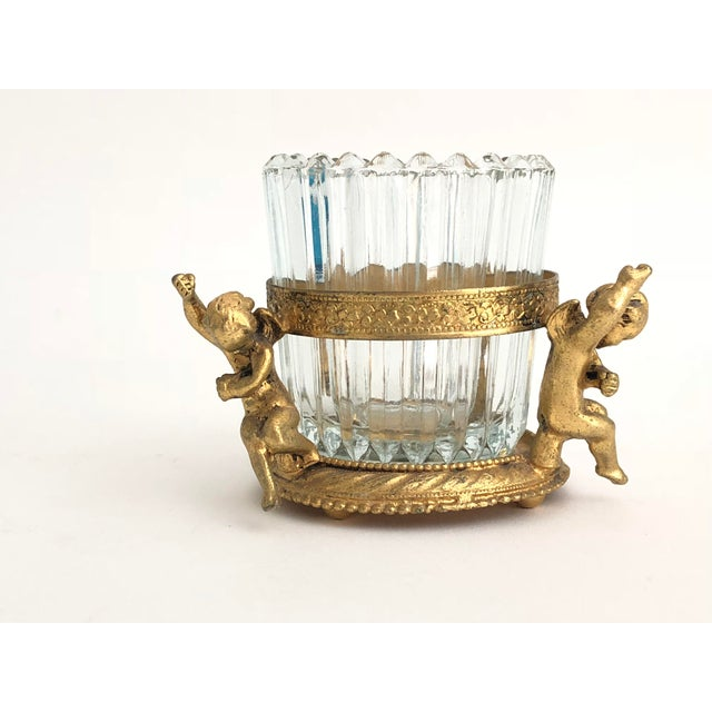 Mid-century gold filigree vanity accessory with removable ribbed glass insert. Cherubs adorn the gold frame. Suitable for...
