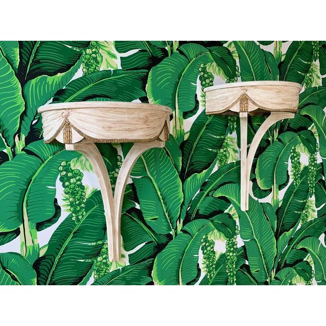 "Pair of mid-century wall brackets in true Dorothy Draper style. Each has secret ""stash box"" below shelf. Decorative carved..."
