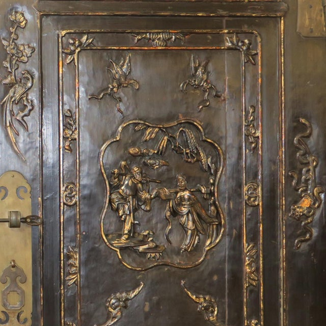 Wood Antique Chinese Black Wedding Wardrobe Cabinet With Gold Carvings For Sale - Image 7 of 12