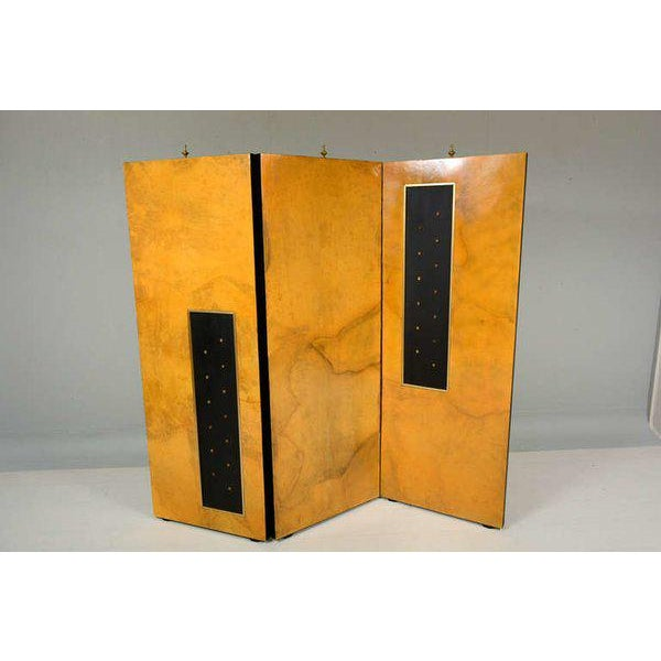 Screen or room divider by Mexican Designer Arturo Pani. Three panel screen with parchment on one side and gold leaf on the...