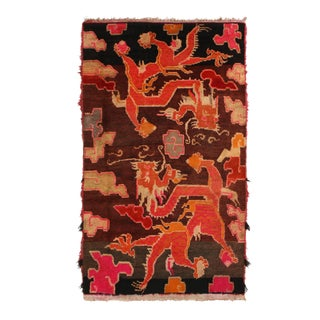Antique Tibetan Orange and Brown Wool Rug With Dragon and Cloud Motifs For Sale