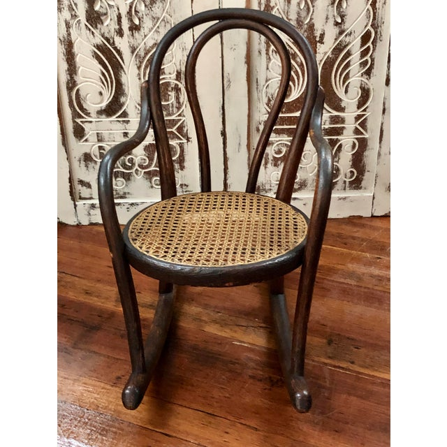 Antique Vintage Thonet Bentwood Childs Cane Set Rocker. This is a classic style Thornet Bentwood Childs rocker. It has a...