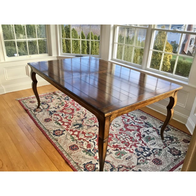 A stunning French country distressed dining table for entertaining a large group. A simple design that features a...