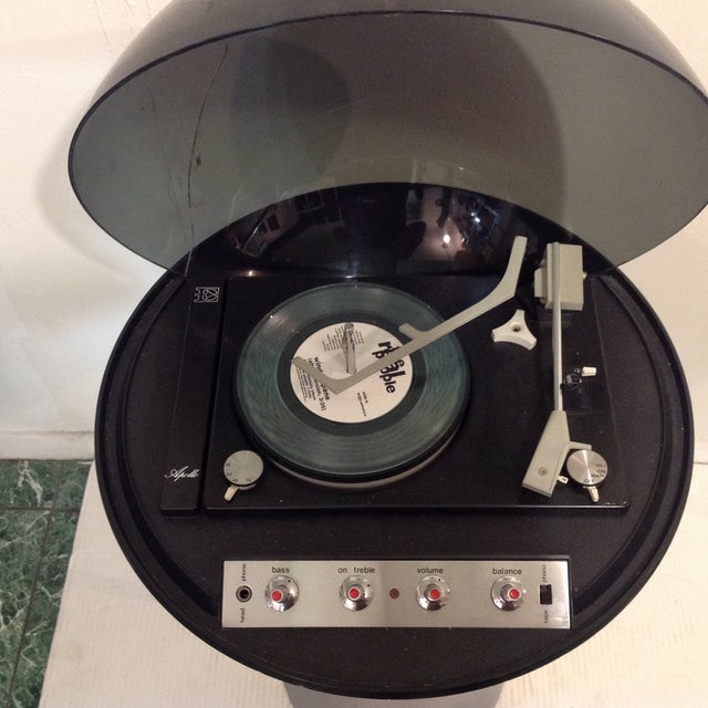 Vintage Electrohome Apollo record player on a tulip style base. The player has some scuffs and light marks. There is a...
