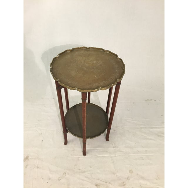 This antique folding table with two decorated scalloped solid brass trays is at least 75 years old, likely much older. The...