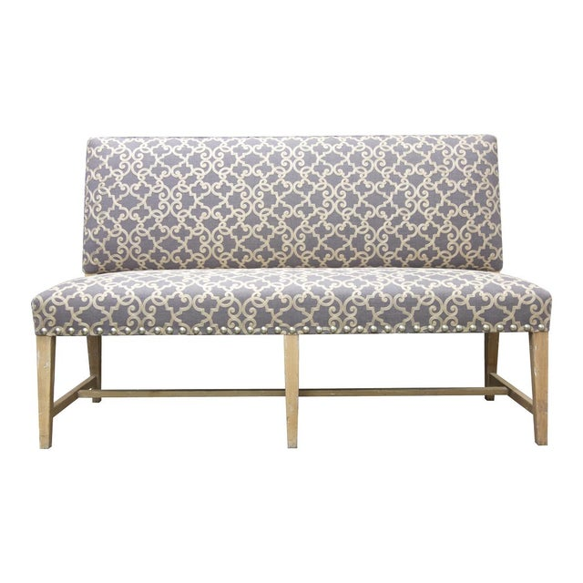 Featuring the Fremarc Designs banquet with stud nail heads. Shown in a Driftwood finish and beige and gray fabric.