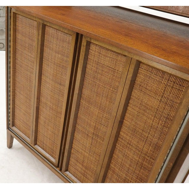 Mid-Century Modern walnut two caned doors five drawers tall dresser high chest of drawers. Standing on tapered modern...