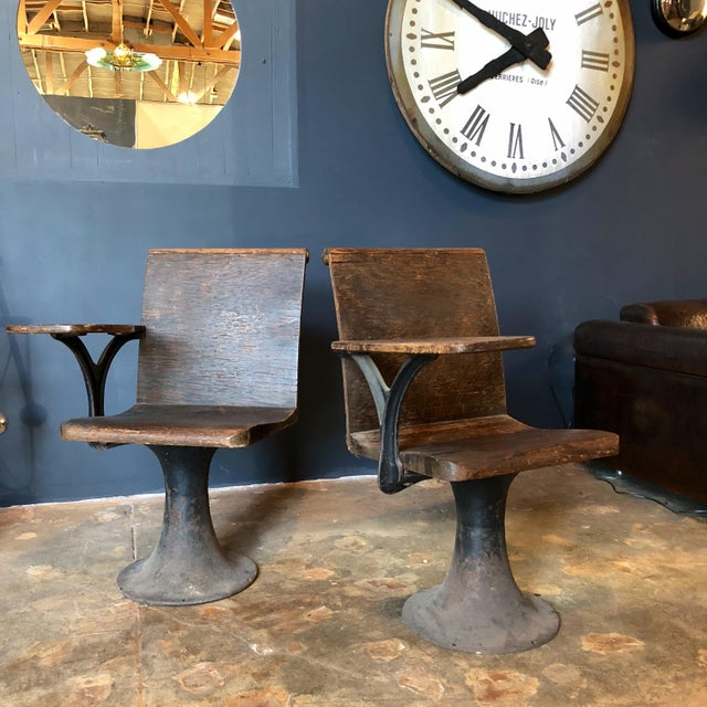 1920s American pair of industrial cast solid wood school desks with iron base.