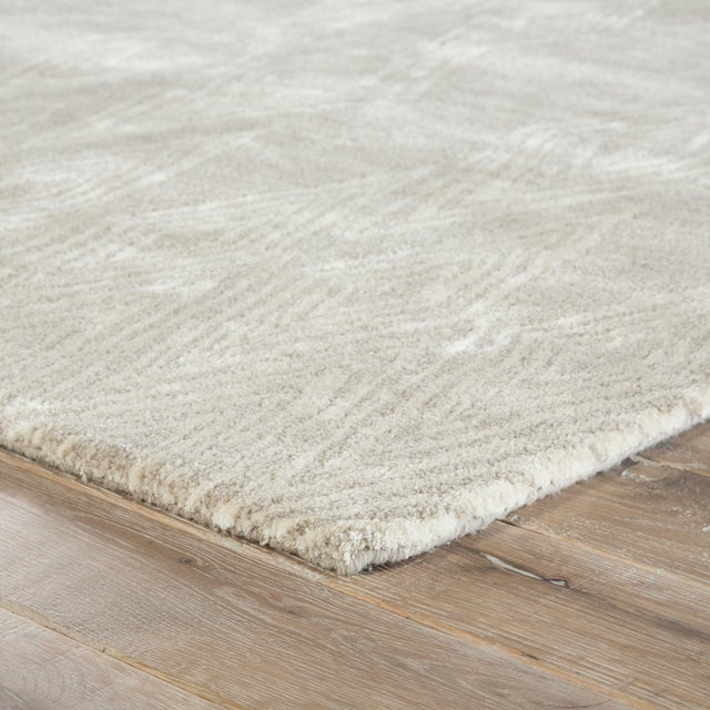A feminine take on Southwestern style, this hand-tufted area rug features an exclusive design by Nikki Chu. Light beige...