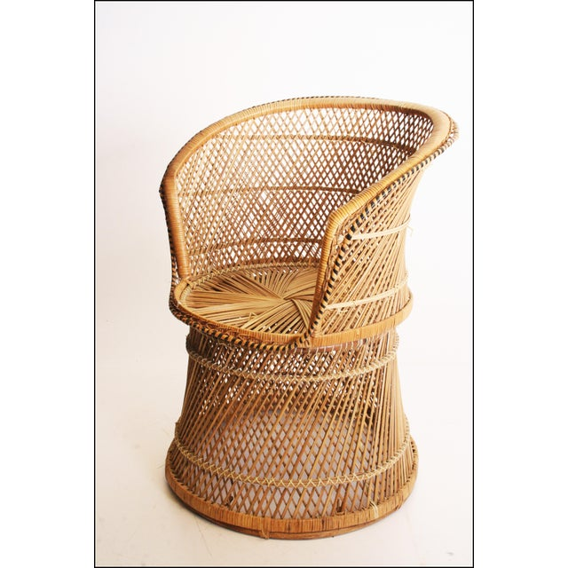 Vintage Wicker PEACOCK Chair. Piece is in excellent condition. Very clean. Chair can hold a lot of weight. High round...