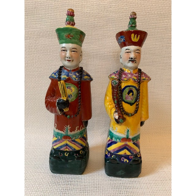 A pair of brightly colored and detailed Chinese Figurines.