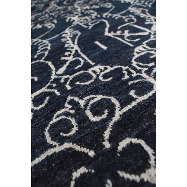 Hand-Knotted with hand-spun wool, woven in Afghanistan. This beautifully designed rug will be sure to stand out in any room.
