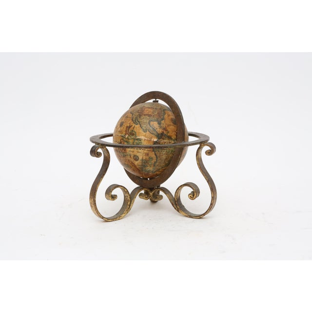 Here's a nice piece for the library or desk. It is a miniature globe fashioned in the Old World style. It is in very good...