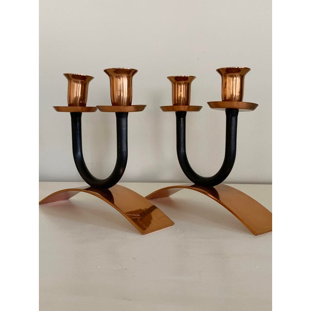 Unique minimalist candle holder pair from mid-century. Black metal and copper candleholders have opposing semi-circular...