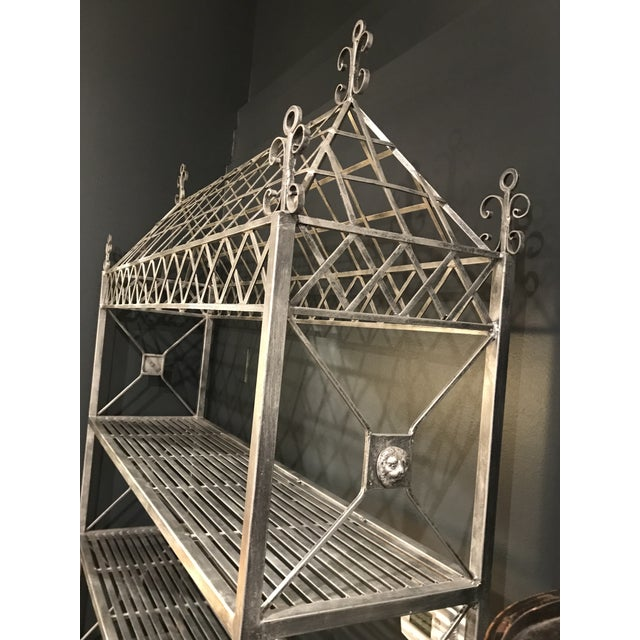 Description: This is an elaborate garden bakers rack with a distressed metal look and a ornamental cage top Shelves: 3...