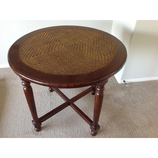 This is a Bassman Blaine unique solid wood indoor table with a woven wicker top. Could be used as a side table by bed,...